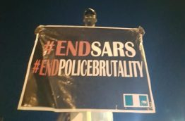 A participant in the #EndSARS protest displaying a now popular slogan.