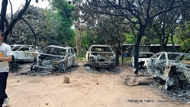Burnt vehicles in Ositachuckwu's workshop