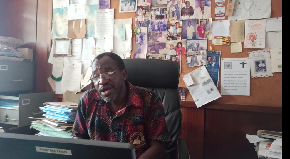 Professor Oluwafemi Oluwadare in his office Photo Credits: Alfred Olufemi / PREMIUM TIMES