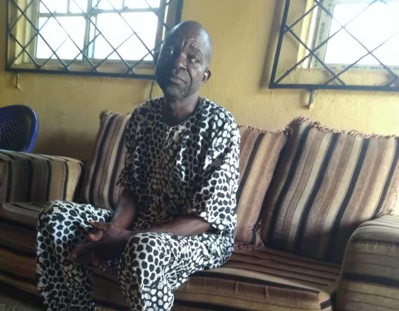 Edesah Osah, the town crier of Idumesah kingdom, Ikah North East LGA, Delta state sitting at the chiefs palace