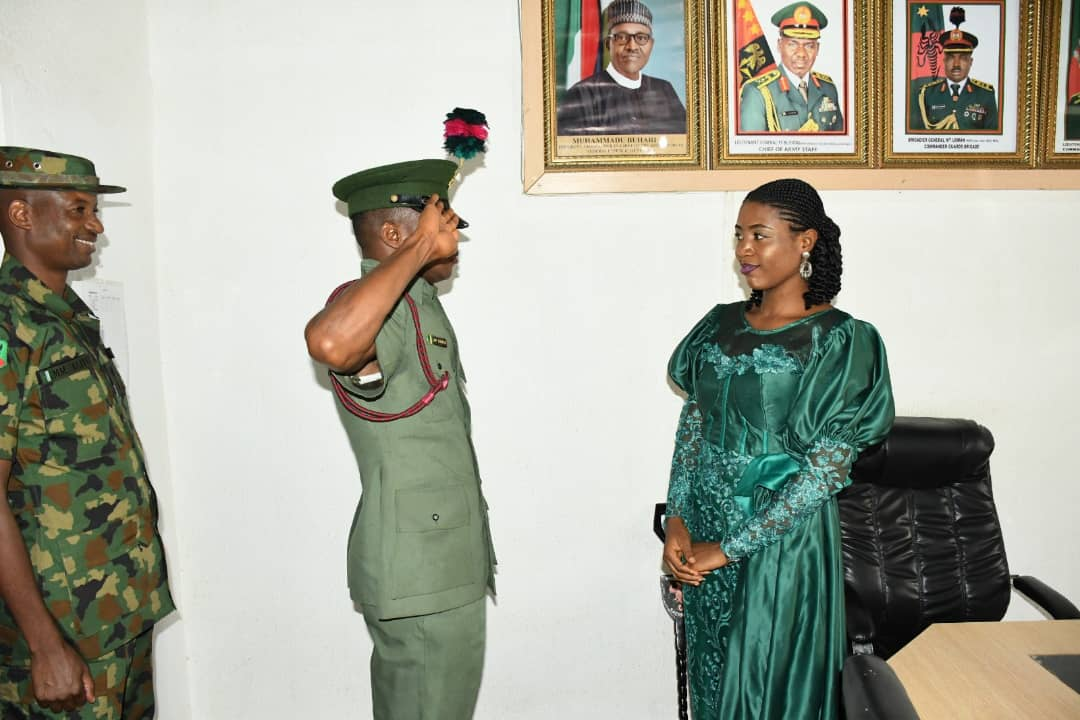 The late Colonel Felix Kura with his wife, Susan, and a commander when he was decorated as a captain in August, 2020
