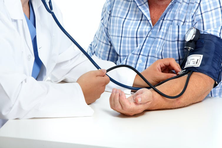 Some risk factors, such as hypertension, are known. But why do some seemingly healthy people get severe COVID? kurhan/Shutterstock