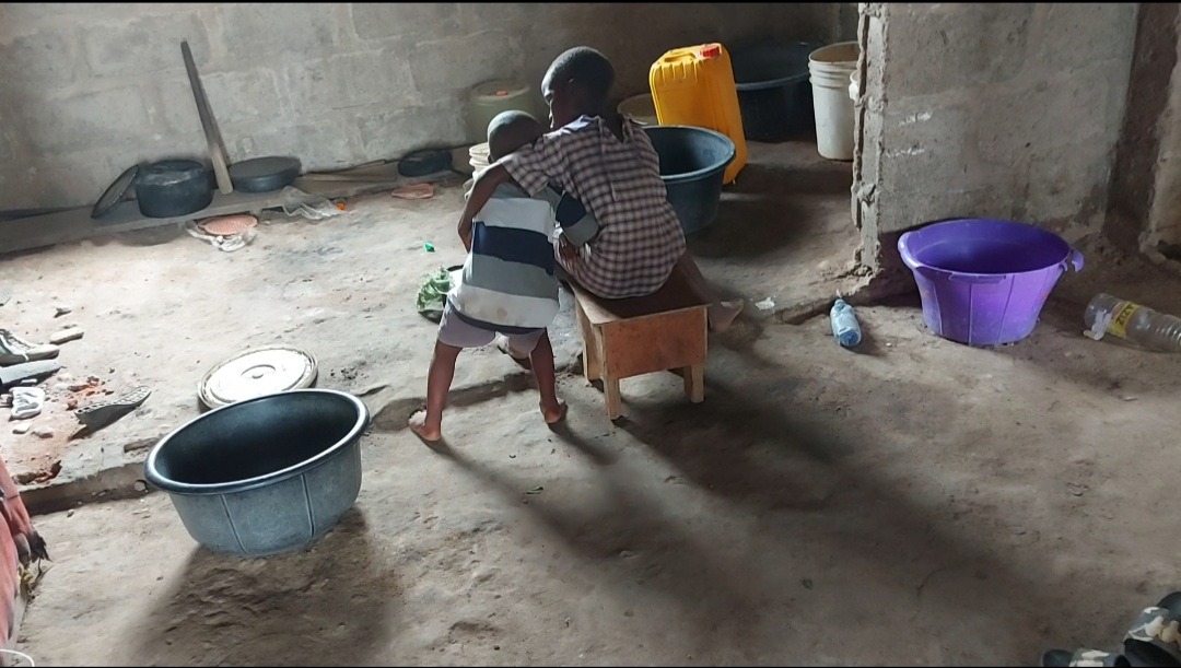 A backview of the two children Titilayo Benson had in Kirikiri Benson.