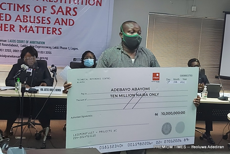 Adebayo Abayomi, whose mother was killed by a police bullet receiving N10 million from the panel.