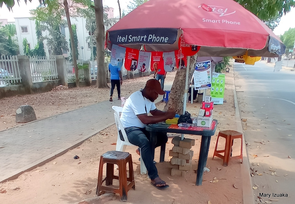 Mr Ismila a SIM card registration agent at Bannex
