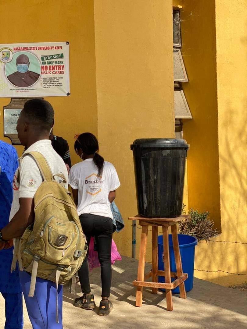 Students taking turns to wash hands at Nassarawa state University.