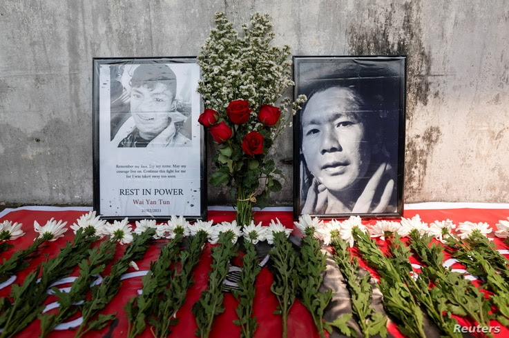 Flowers are left at a makeshift memorial in Yangon, for the people killed during a protest against the military coup in Mandalay on the previous day, Myanmar, Feb. 21, 2021.