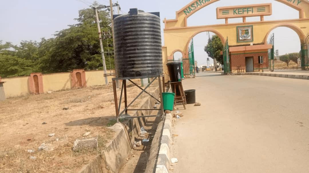 NSUK main gate, with the redundant handwashing facility
