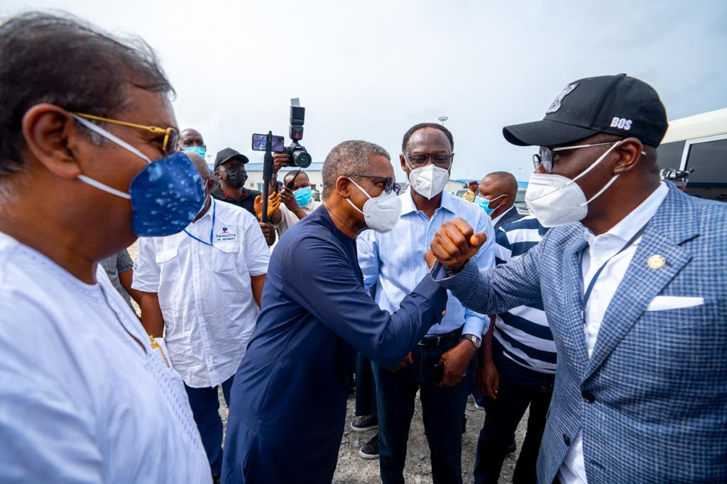 Lagos State Governor, Mr. Babajide Sanwo-Olu (right) exchanging greetings with President, Dangote Group, Alhaji Aliko Dangote (second left), while Group Executive Director, Strategy, Capital Projects and Portfolio Development, Dangote Industry Ltd., Mr. Devakumar Edwin (left) and Chairman, Lekki Free Zone Development Company, Mr. Abiodun Dabiri (second right), during the Governor's working visit to the Dangote Refinery at Lekki Free Trade Zone, Ibeju-Lekki, on Saturday, March 20, 2021.