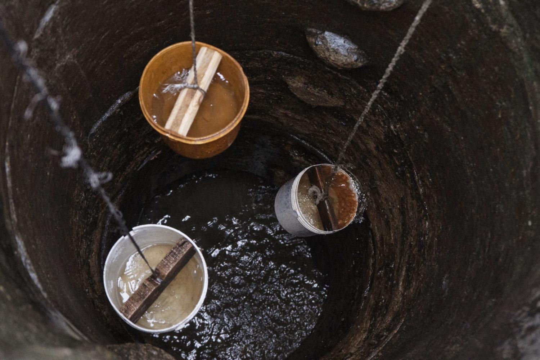 Sagbo Kodji islanders use buckets to collect water from open wells. [PHOTO CREDIT: Nengi Nelson]