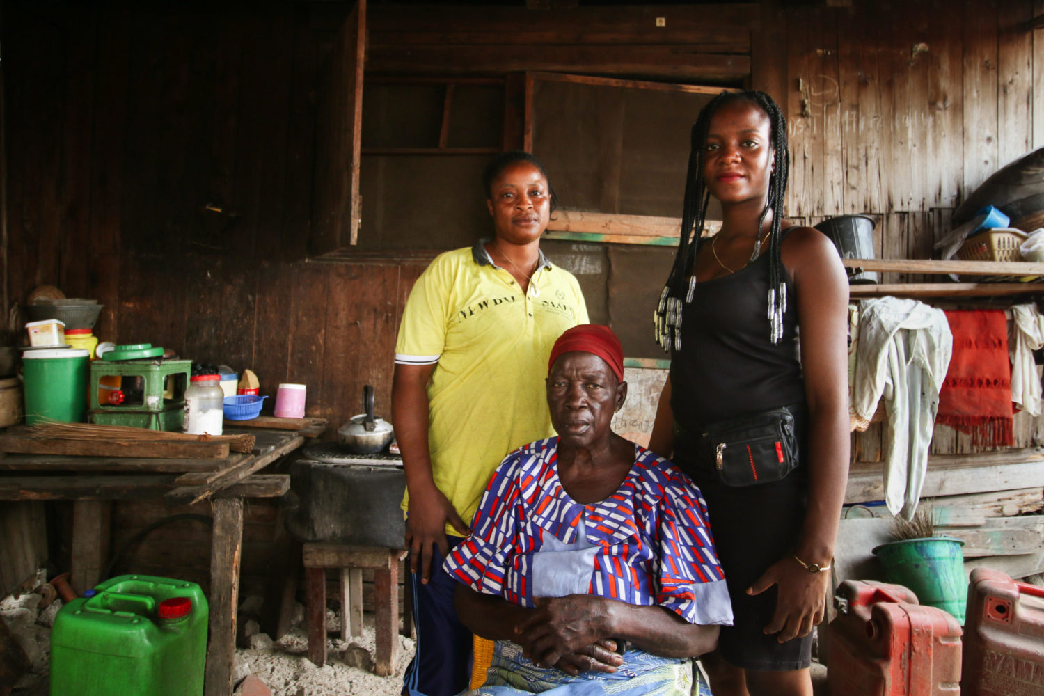 Sagbo Kodji residents Bolanle Taiwo, left, her niece Mariam Azeez, and her mother, Mrs. Abidoye Comfort, inside their one-room apartment. [PHOTO CREDIT: Nengi Nelson]