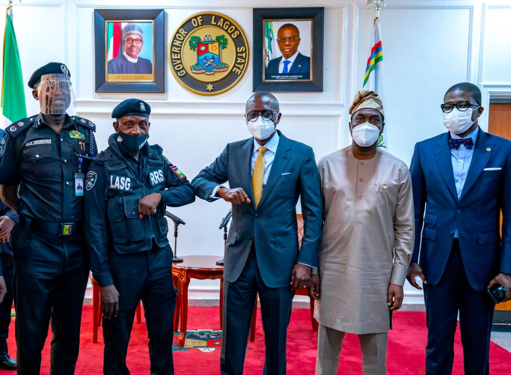 L-R: Commissioner of Police, CP Hakeem Odumosu; Police officer assaulted by traffic offender, ASP Sunday Erhabor; Lagos State Governor, Mr. Babajide Sanwo-Olu; his deputy, Dr. Obafemi Hamzat and Head of Service, Mr Hakeem Muri-Okunola, during a ceremony to honour Erhabor at Lagos House, Ikeja, on Monday, April 19, 2021.