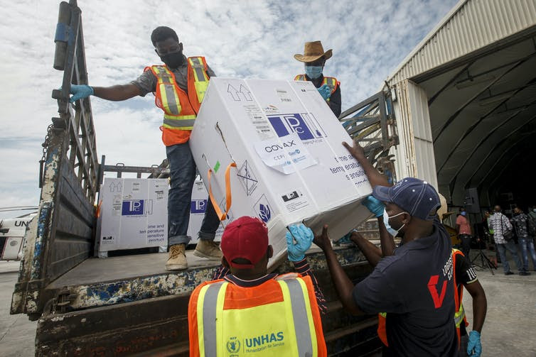 Boxes of AstraZeneca COVID-19 vaccines manufactured by the Serum Institute of India and provided through the COVAX global initiative arrive at the airport in Mogadishu, Somalia. Farah Abdi Warsameh/AP.