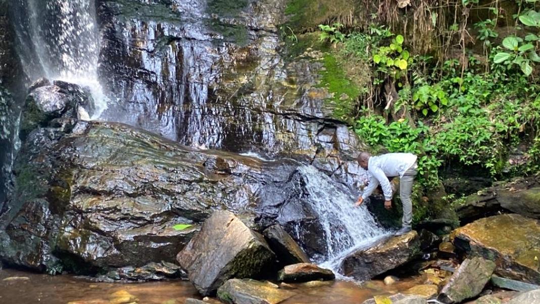 A tourist washing his face at Erin-Ijesha waterfall