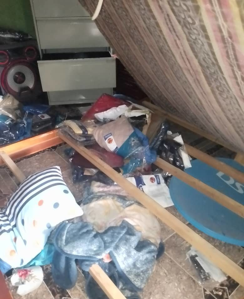 Photos of mangled doors of the victim's home.