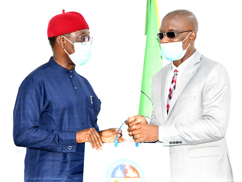Delta Governor, Senator Dr. Ifeanyi Okowa (left) presenting a souvenir to outgoing Chief Judge of the State, Justice Marshall Umukoro during a courtesy call by Judges in the state led by the Chief Judge on the Governor in Asaba. Tuesday. PIX: BRIPIN ENARUSAI