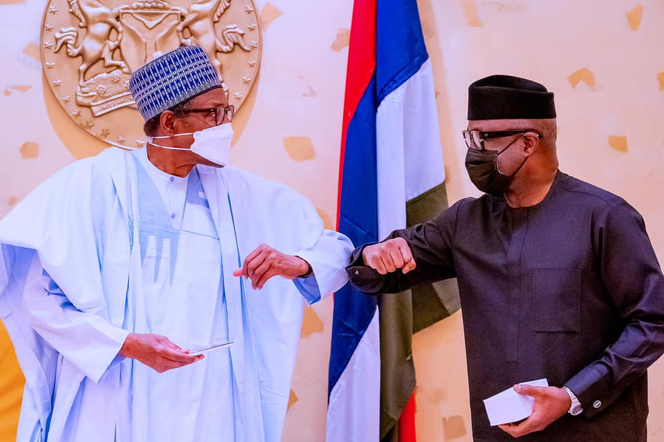 President Buhari receives a 'Made in Nigeria' android phone from the Minister of Trade and Investment [PHOTO CREDIT: @Bashir Ahmad]