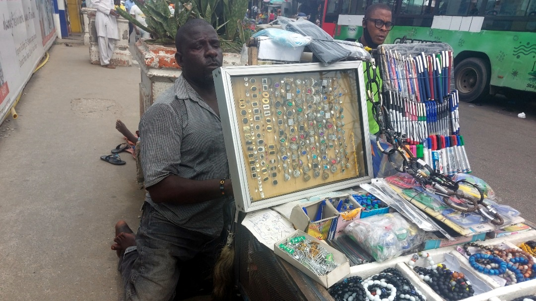 Bello Usman, a person with disability selling wares at Marina road.