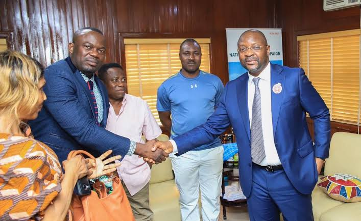 Olamide George with the Sports Minister, Sunday Dare
