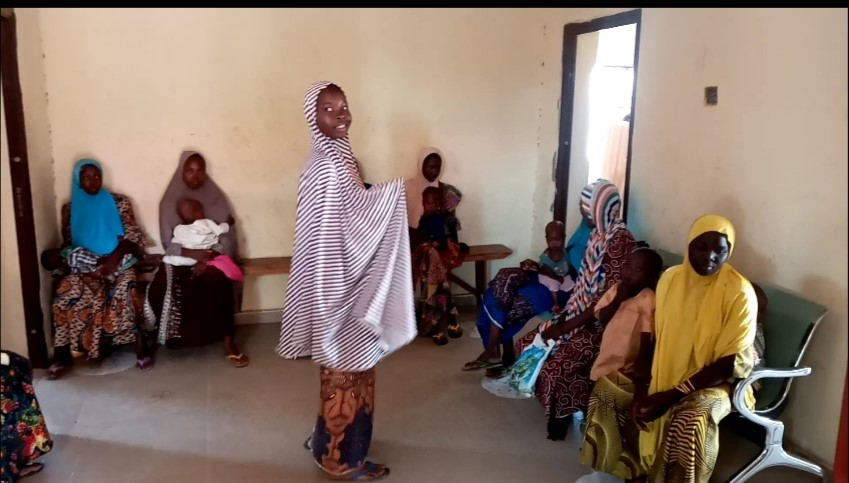 Group of IDP women and their malnourished children awaiting treatments at Dalori IDPs camp 2 clinic