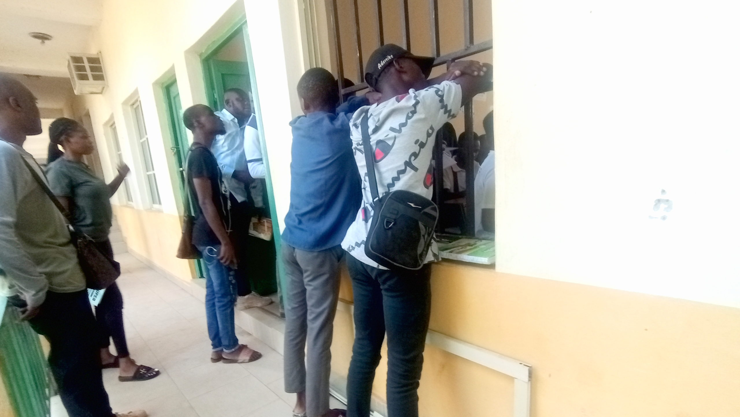 Students hanging outside a lecture theatre in the Federal University Oye-Ekiti.