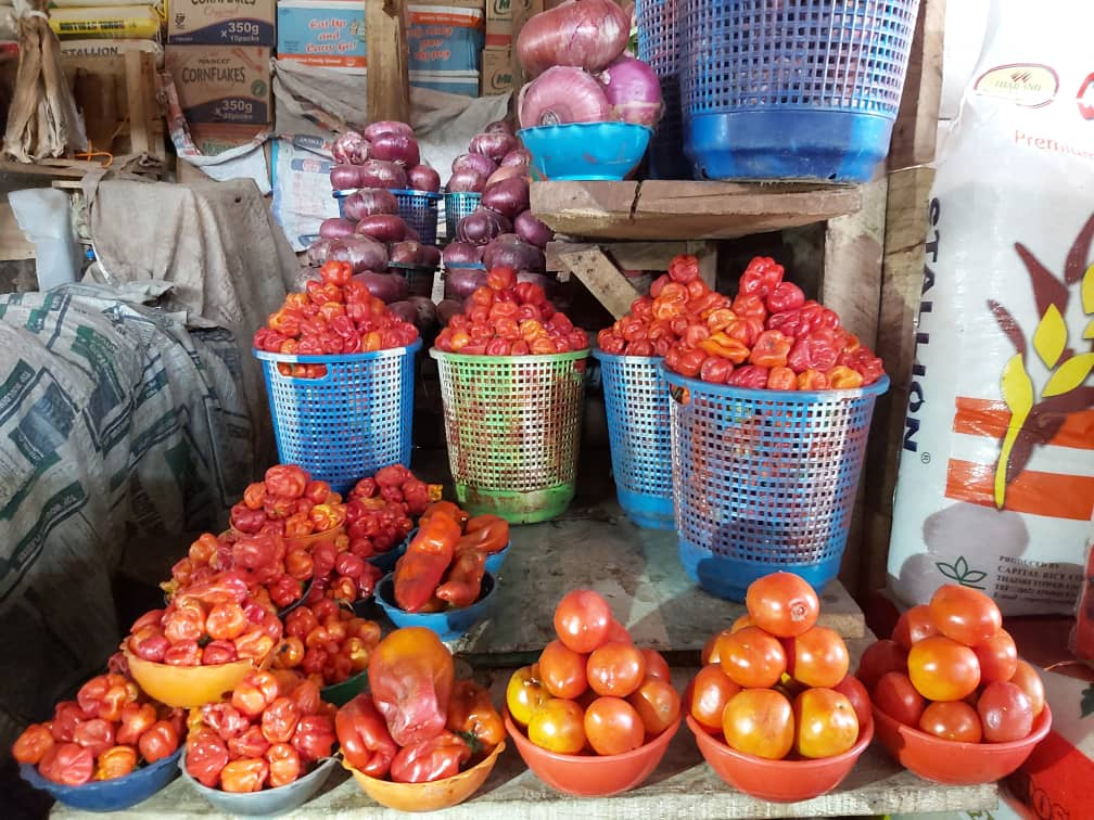 Onions, Peppers and Tomatoes on display at the market