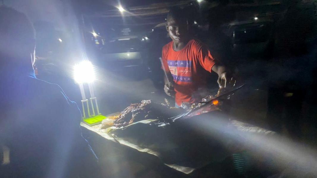 Kabir, preparing Suya for a customer at Ojota