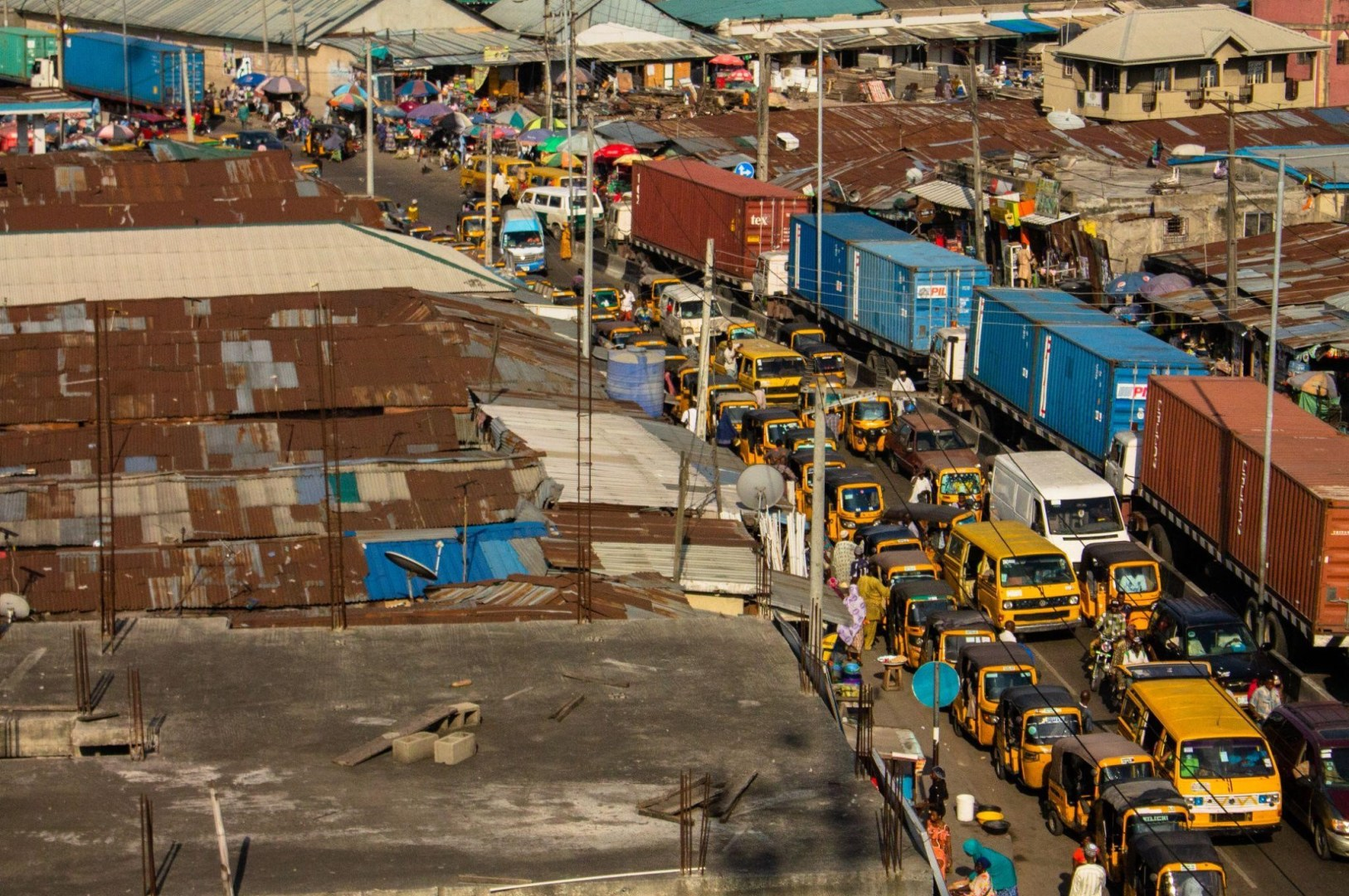 (Inside the 'go slow' portraying the busy traffic in Lagos where Covid-19 index case was discovered. Photo by Dami Akinbode on Unsplash)