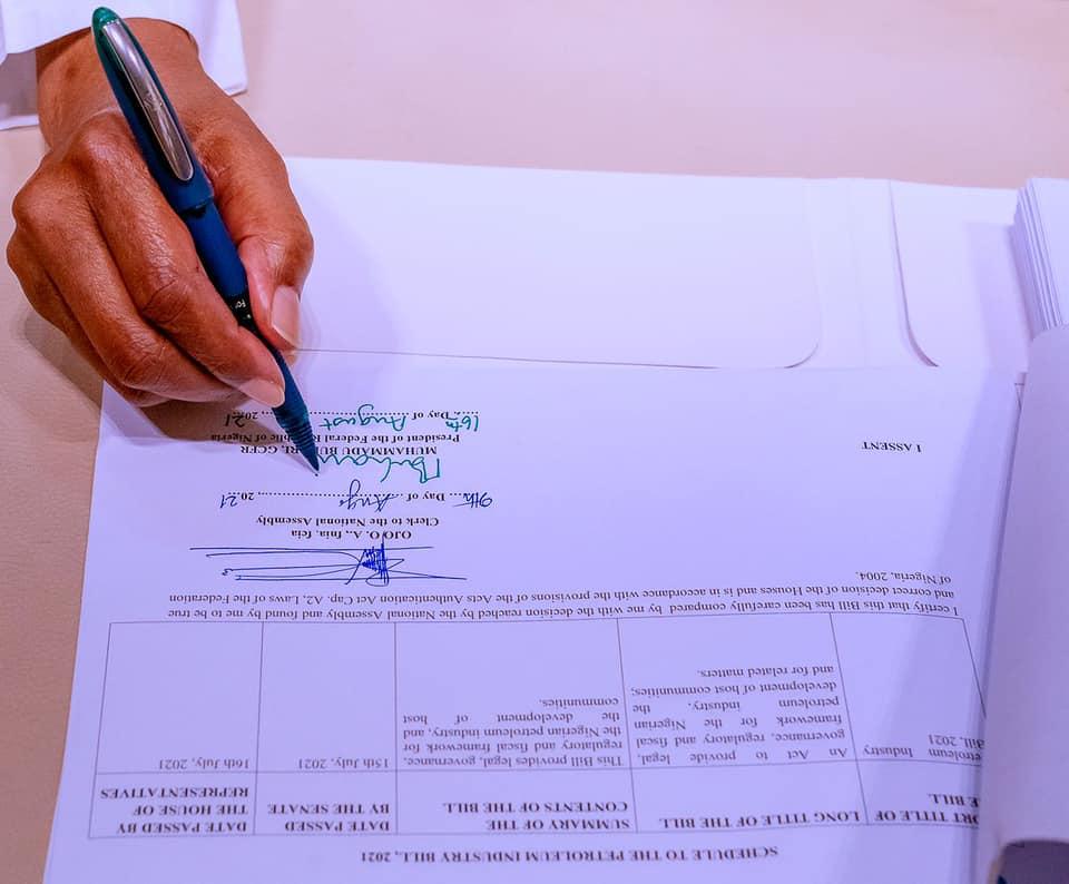 President Muhammadu Buhari signing the Petroleum Industry Bill (PIB) into law [PHOTO CREDIT: @MuhammaduBuhari]