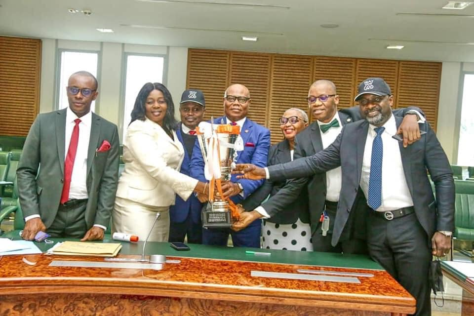 The Commissioner for Youth and Sports, Monday Uko, with the trophy