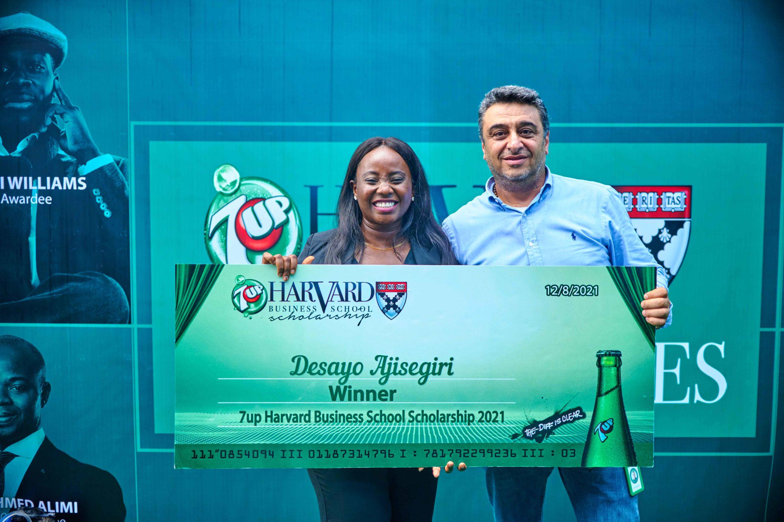 Ziad Maalouf, MD, SBC Nigeria, presenting Desayo Ajisegiri, Winner, 2021 7UP Harvard Business School Scholarship with the scholarship.