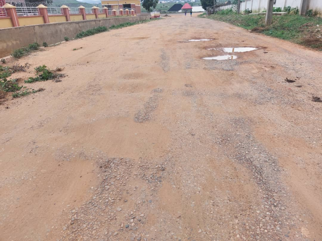 Failing road to the FCT High Court, Adzata.