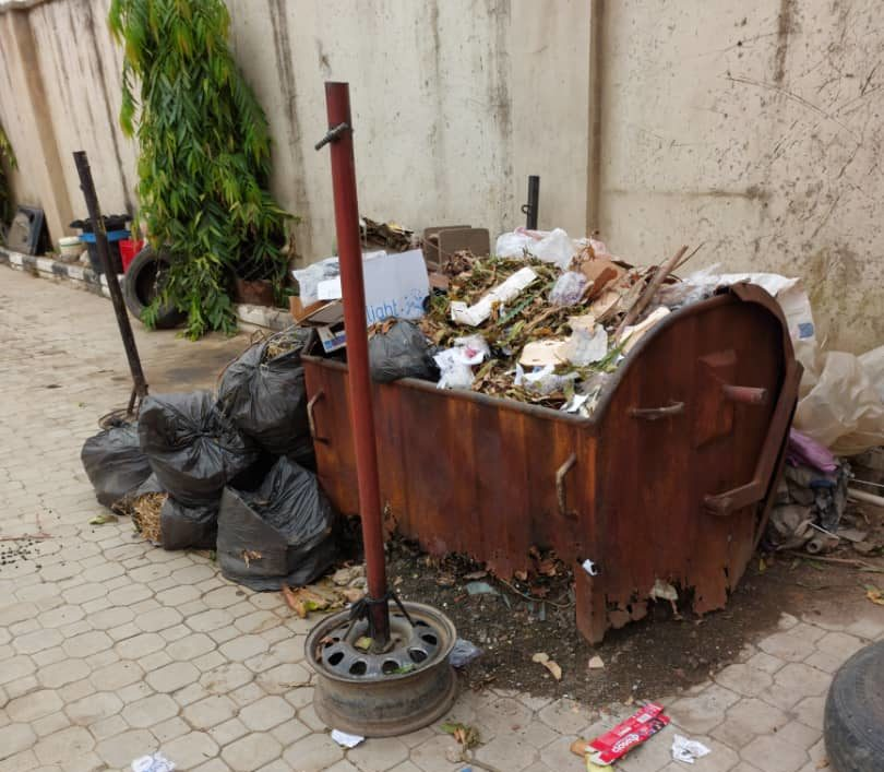 A refuse container running over on the compound of the FCT High Court, Zuba.
