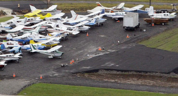 Small airplanes are parked close together