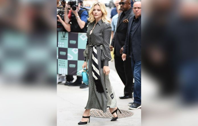 Chloe Grace Moretz in a kenzo sweater and skirt.