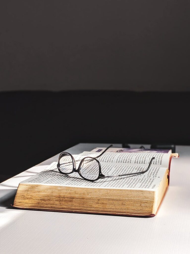 photo of eyeglasses on top of the book
