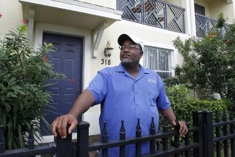Curtis Jones stands in front of his two-story townhouse in Delray Beach