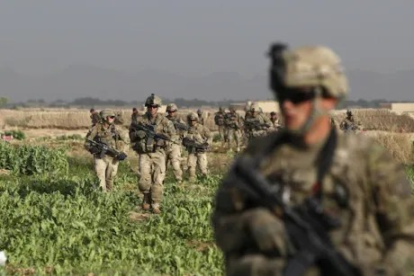 U.S. Army soldiers from 4-73 Cavalry Regiment, 82nd Airborne Division walk during a mission in Zhary district of Kandahar province, southern Afghanistan April 17, 2012
