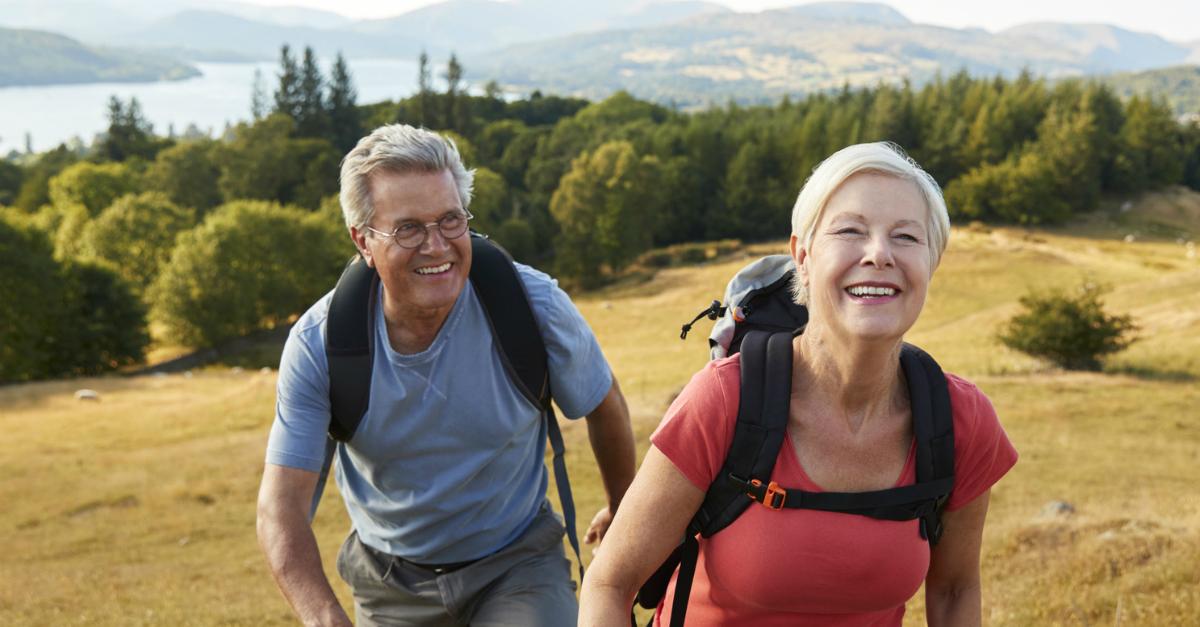 senior couple hiking in beautiful countryside