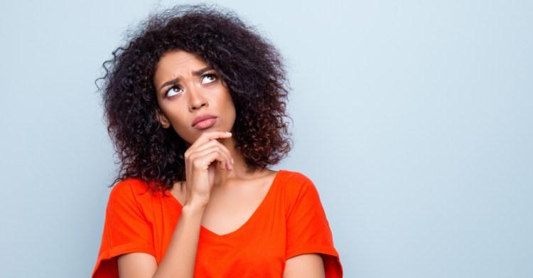 woman wondering looking up doubting