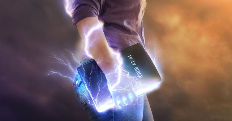 man holding bible giving off electricity, how satan uses scripture against you