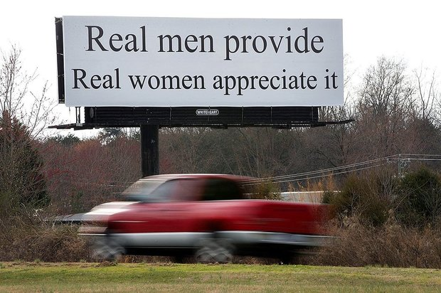 A vehicle drives by a billboard in North Carolina that has drawn criticism.