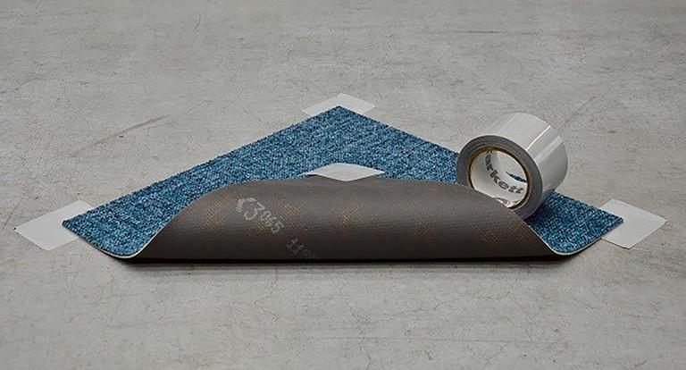 makes laying carpet tiles easy