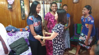 Sister Becky Craven visits with a group of young women in Fiji during a trip to the Pacific Area in October 2019.