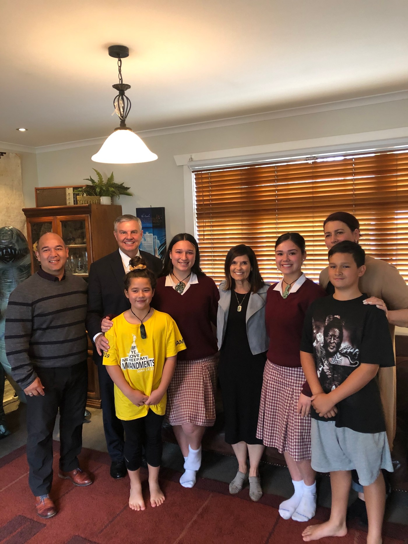 Sister Becky Craven, center, and her husband, Brother Ron Craven, second left, pose with a Latter-day Saint family in Christchurch, New Zealand, during a ministering visit to the family's home during Sister Craven's trip to the Pacific Area in October 2019.