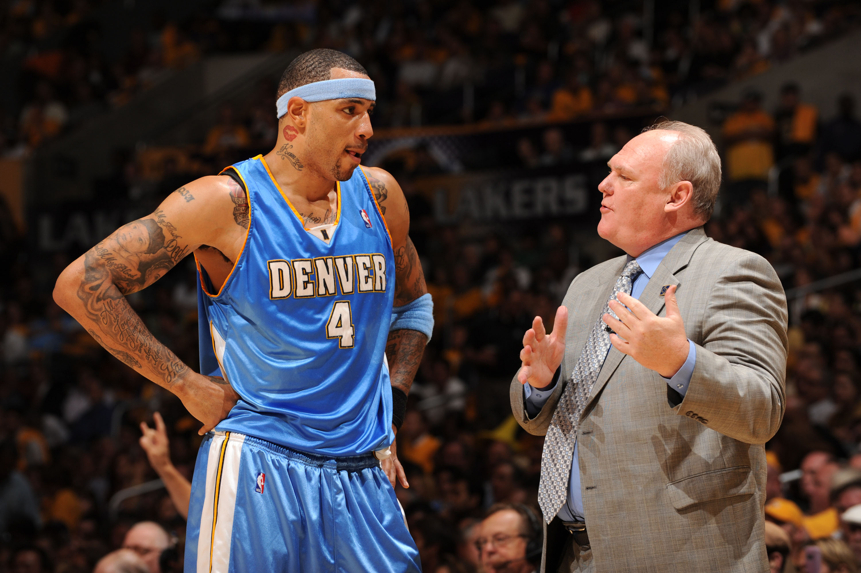 LOS ANGELES - MAY 19: Kenyon Martin #4 of the Denver Nuggets receives instruction from Head Coach George Karl while taking on the Los Angeles Lakers in Game One of the Western Conference Finals during the 2009 NBA Playoffs at Staples Center on May 19, 2009 in Los Angeles, California. NOTE TO USER: User expressly acknowledges and agrees that, by downloading and/or using this Photograph, user is consenting to the terms and conditions of the Getty Images License Agreement. Mandatory Copyright Notice: Copyright 2009 NBAE (Photo by Noah Graham/NBAE via Getty Images)