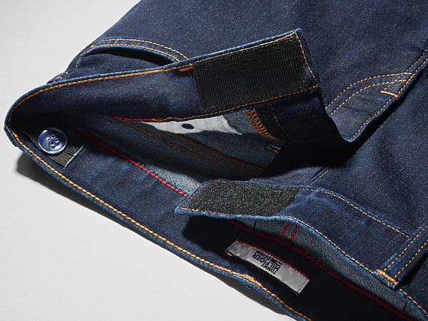 Image shows jean adapted with a magnetic and hook and loop fly, replacing traditional button and zip flies for easier dressing.