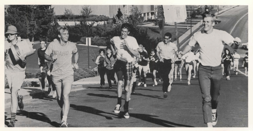 After being defeated by the Cougars 14-7, Vandals are out of the gates and off to WSU on the traditional Walk. (1969)