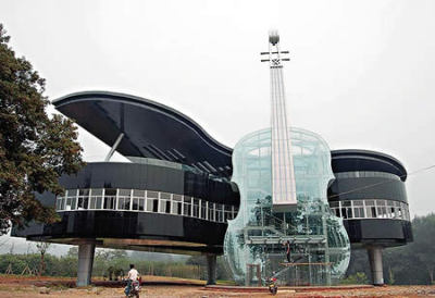 World's Most Creative Buildings The Piano House - Inside the violin is the escalator to the building.