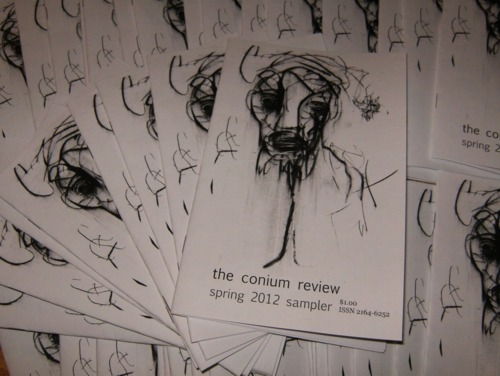 "A pile of sampler booklets from ""The Conium Review."""